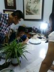 杨国钧生活-给学生上课。和四川省诗书画院师生教学成果展览会上。【图1】