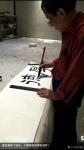 丁国祥生活-与叔叔著名画家丁培生同在一张案台创作! 叔叔丁培生在书写《【图1】