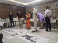 艺术家刘建国生活:神州阳光书画院书画家为企业发展助力活动。【图2】